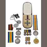 A collection of Boer War and First World War Medals, All contained in a 1914 Princess Mary's git tin with original Christmas card, comprising Queens South Africa medal, with bars, Orange Free State, Cape Colony, engraved (Capt: Lord Chas: Kennedy, P of W Lt: Horse.), with another Queen's South Africa Medal, one bar, Cape Colony (1462 Pte C.Kennedy. 17th Coy Imp: Yeo:), a pair of oval dog tags stamped '22515495 C E Kennedy A', Together with a Military Cross group of three to Lieutenant R.J.Cuninghame,; comprising Military Cross, British War and Victory Medal Pair (Lieut: R.J Cuninghame.), A miniature British War Medal and Victory Medal, a miniature British War Medal and Victory medal and a General service medal with Iraq bar.