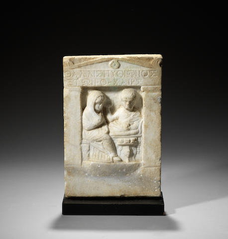 A Roman marble funerary stele