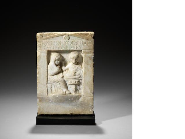 A Roman marble funerary stele