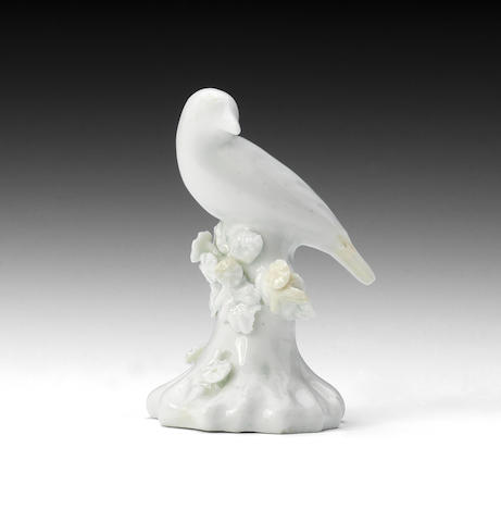 A Lowestoft/Isleworth white porcelain bird (minor repairs)