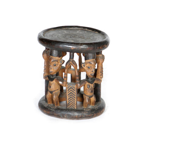 A carved and stained Cameroon Grasslands circular stool