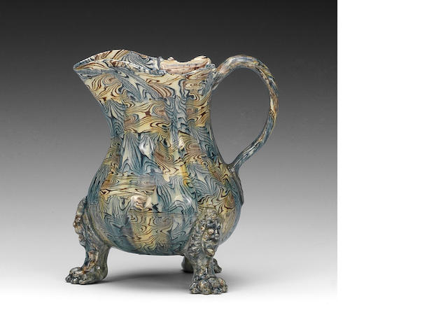 A very fine Staffordshire lead-glazed agateware jug, circa 1755-60