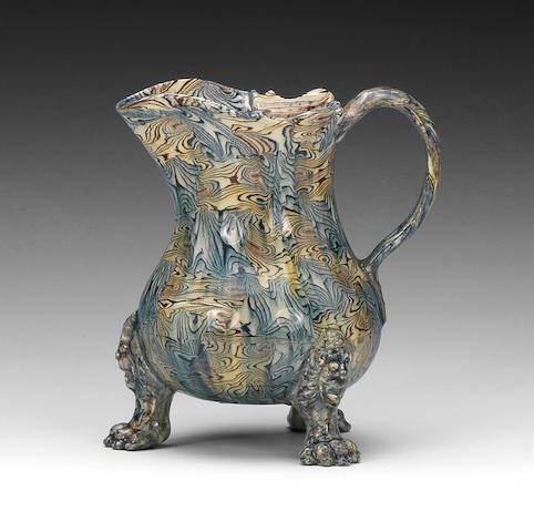 A very fine Staffordshire lead-glazed agateware jug, circa 1755-60