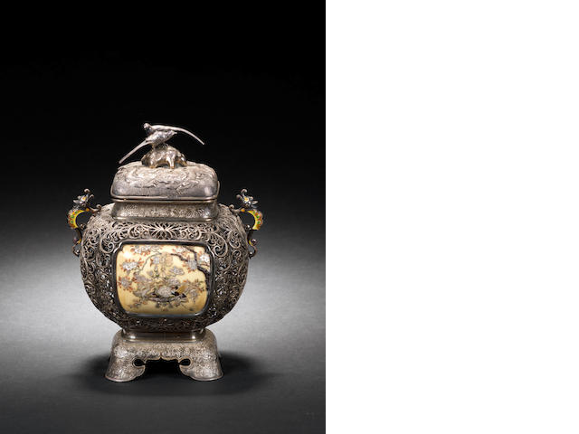 """A Japanese Shibayama-work Koro and cover the openwork exterior body inset on one side with gold lacquer panel depicting cranes and flowering shrubs in mother-of-pearl, coral and ivory and on the other with a similar ivory panel, on stand with four feet, 6""""."""