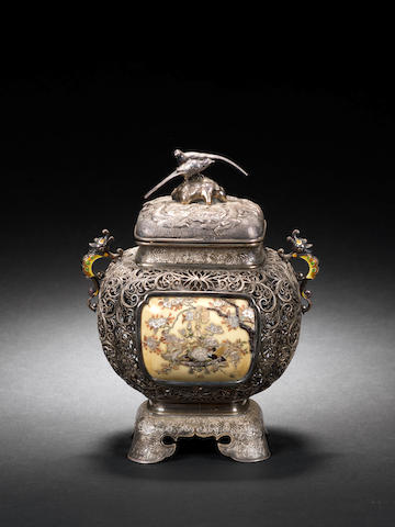 "A Japanese Shibayama-work Koro and cover the openwork exterior body inset on one side with gold lacquer panel depicting cranes and flowering shrubs in mother-of-pearl, coral and ivory and on the other with a similar ivory panel, on stand with four feet, 6""."