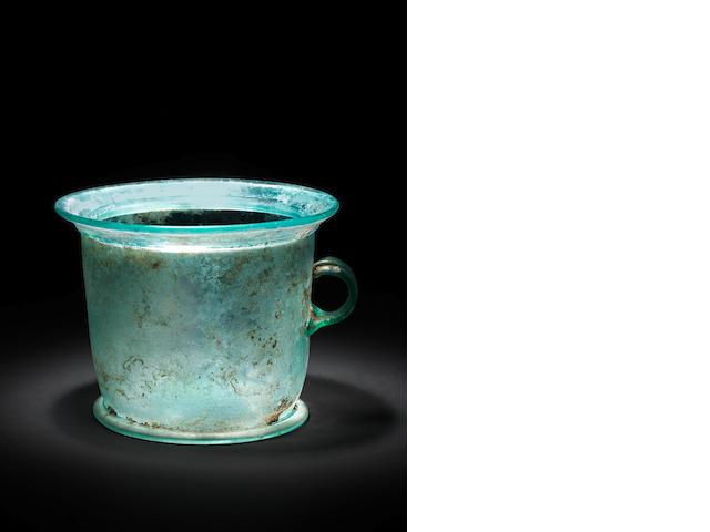 A Roman bluish-green glass modiolus