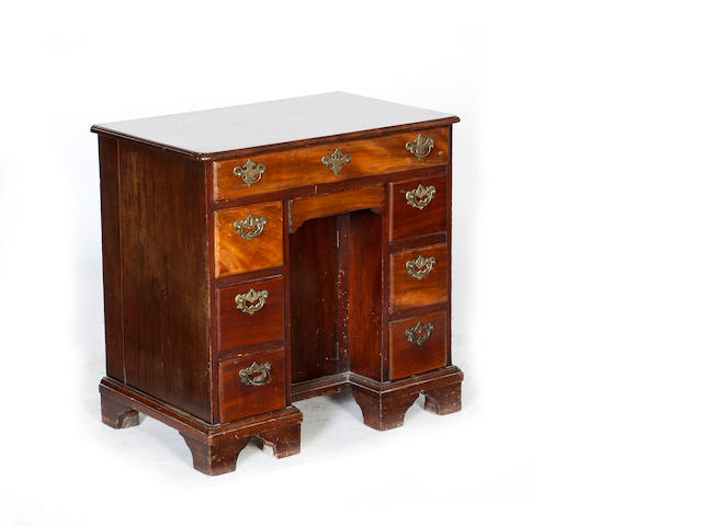 A George II and later mahogany kneehole desk