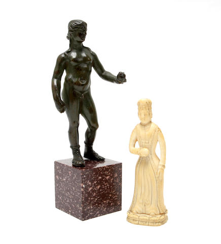 A bronze figure of a Roman athlete