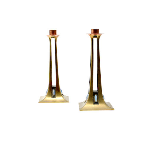 Albin Muller, Germany, (1871-1941)A pair of copper and brass candlesticks
