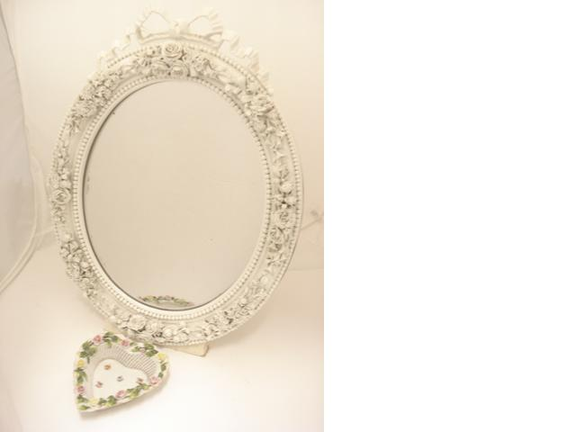 A French white porcelain mirror  Circa 1900