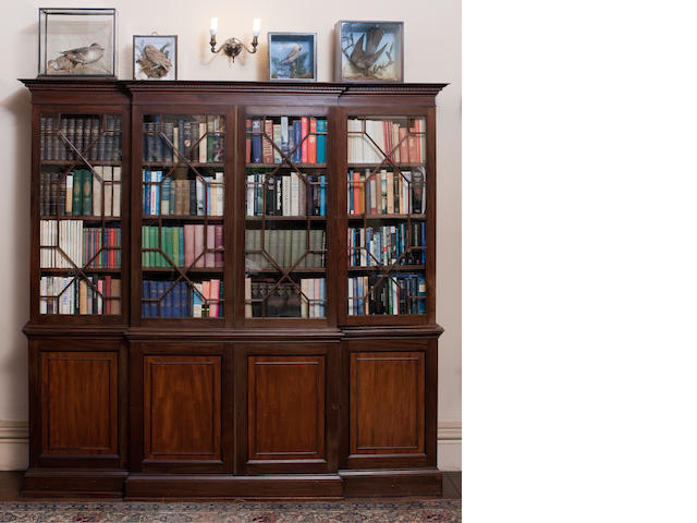 A mahogany breakfront bookcase in the George III style