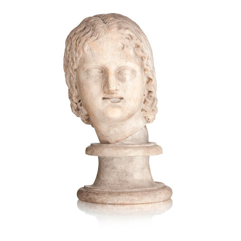 A Roman marble head of a young woman Circa 2nd century A.D.