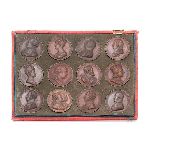 A cased set of early 19th century bronze medallions