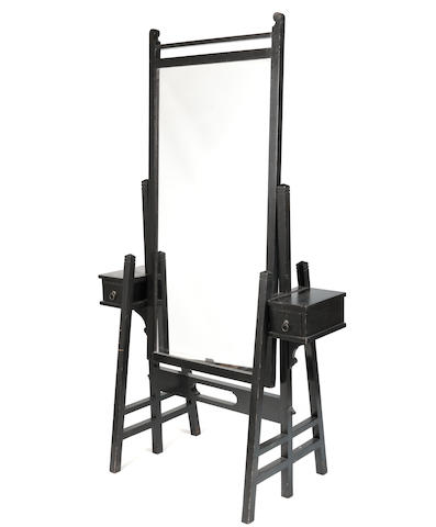 An early 20th century Glasgow School style ebonised cheval mirror