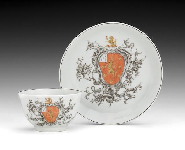 A Worcester armorial teabowl and saucer, circa 1758