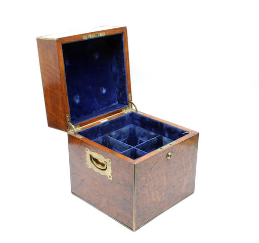 A late Victorian oak and brass bound decanter box