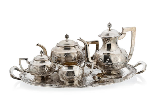 A Chinese export silver tea and coffee service and oval tray,  by Tuck Chong, circa 1900