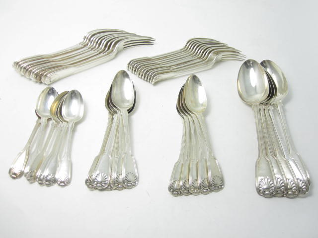 A Victorian matched part canteen of silver flatware   various makers, to include William Eaton, London 1835, 1838 and 1841