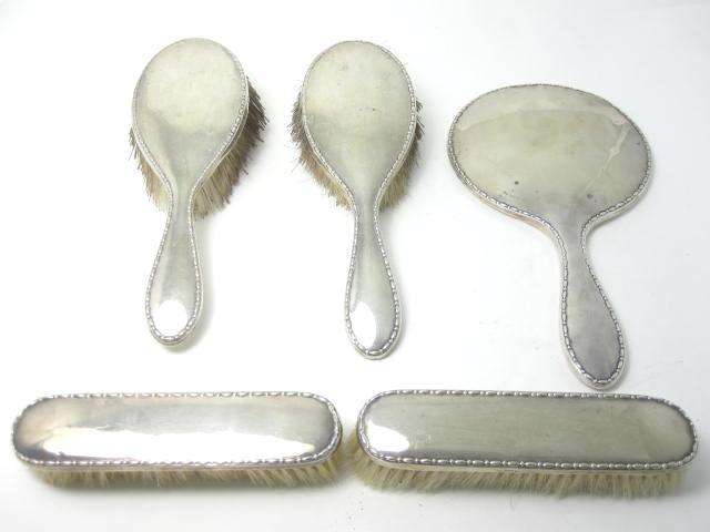 A five piece silver-mounted brush set by Walker & Hall, Sheffield 1924