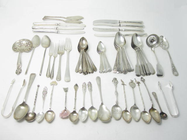 A quantity of silver teaspoons various makers and dates