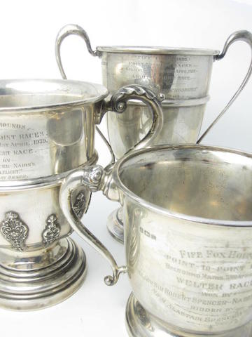 Three twin handled silver presentation cups Various makers and dates  (3)