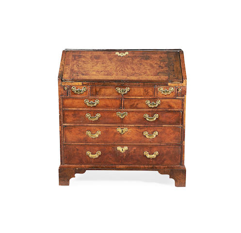 A George I walnut and featherbanded bureau