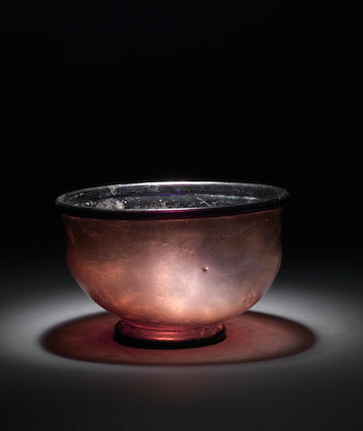 A large Roman purple footed glass bowl