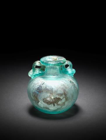 A Roman bluish-green glass aryballos