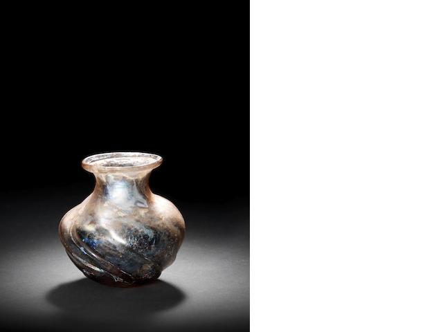 A Roman pale purple glass jar