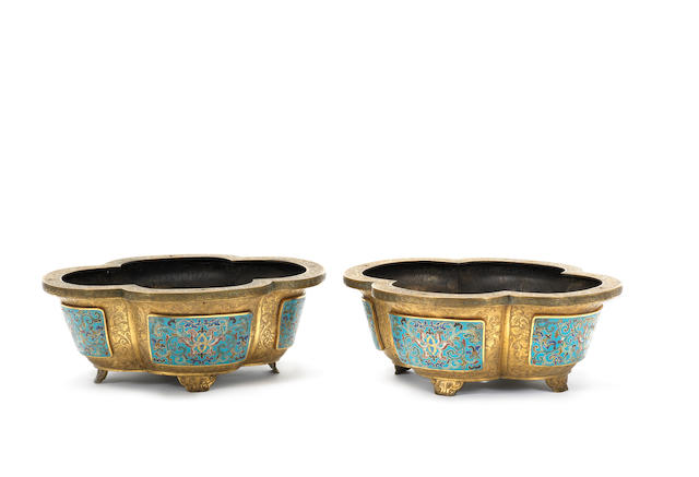 A pair of Imperial gilt-bronze and cloisonné enamel lobed jardinières Qianlong