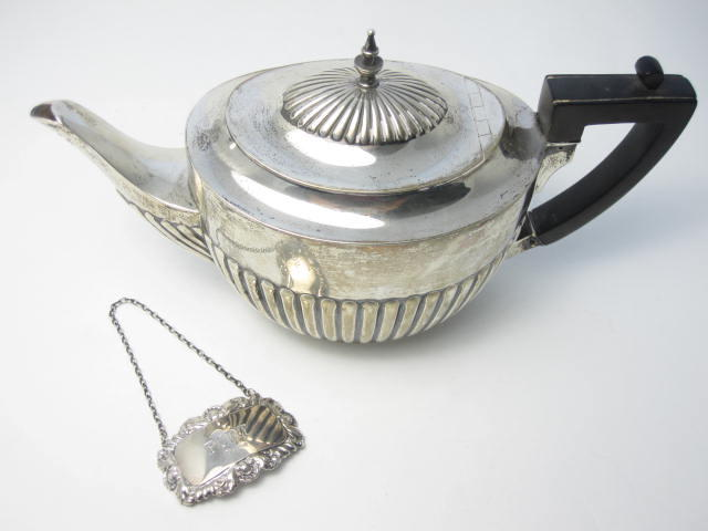 A silver teapot by William Hutton & Sons Ltd, London 1913
