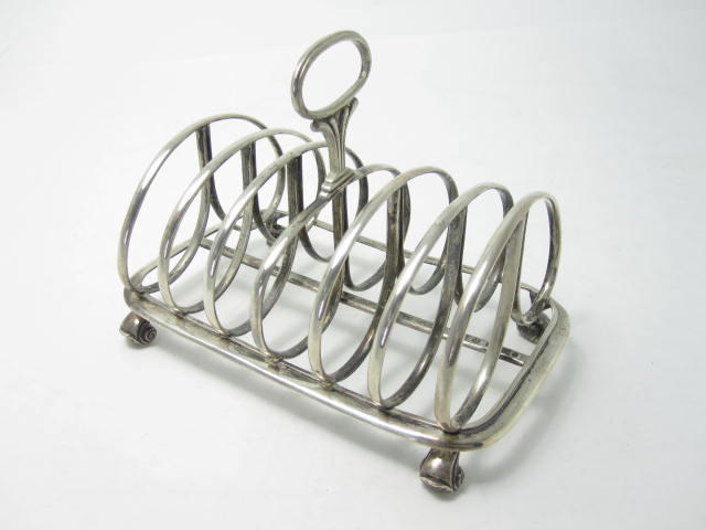 A William IV silver toast rack by W.Cunningham, Edinburgh 1831