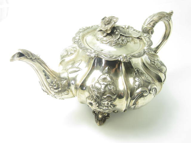A Victorian silver teapot with maker's mark of WH, London 1844