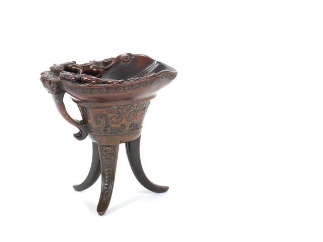 A rhinoceros horn archaistic tripod vessel, jue 17th/18th century