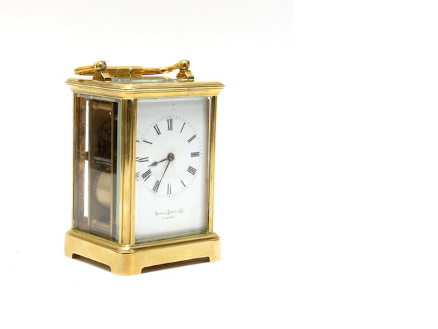A late Victorian brass carriage clock   Inscribed Howell James & Co London