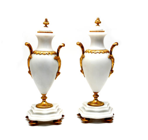 A pair of 20th century gilt-metal mounted marble urns