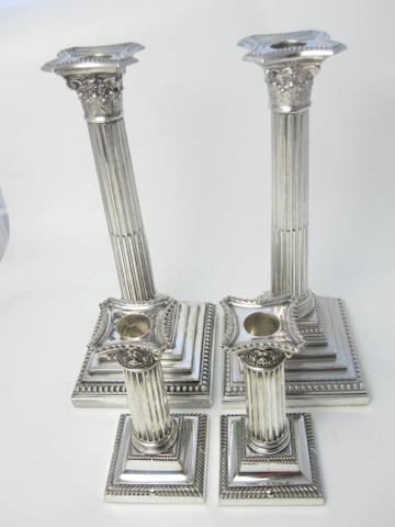 Two pairs of electroplated Corinthian column candlesticks