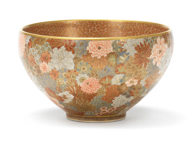 A circular deep bowl,the interior painted with myriad butterflies, the exterior with flowering shrubs, signed Seikozan.