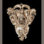 A Baroque style carved and silvered wood cartouche probably 19th century