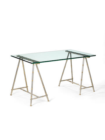 Maison Jansen Table circa 1970  glass steel and gilt metal  74 by 138 by 77 cm 29 1/8 by 54 5/16 by 30 5/16 in.