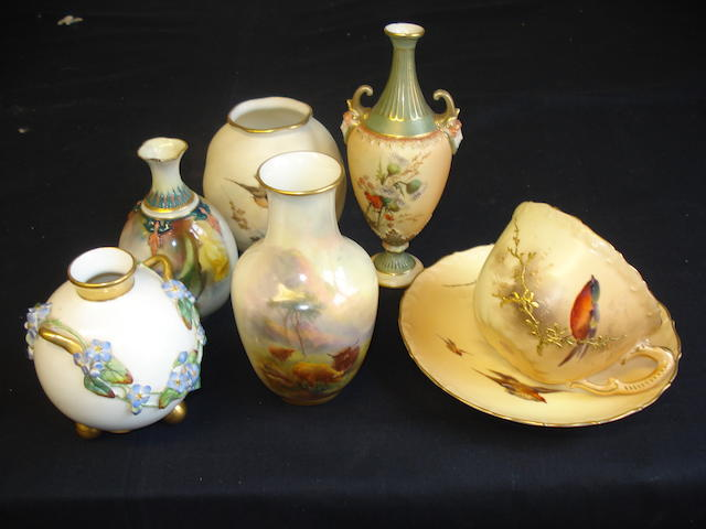 A small collection of Royal Worcester including a vase decorated by Harry Sinton, a cupand suacer, two small vases and two gourd shaped vases