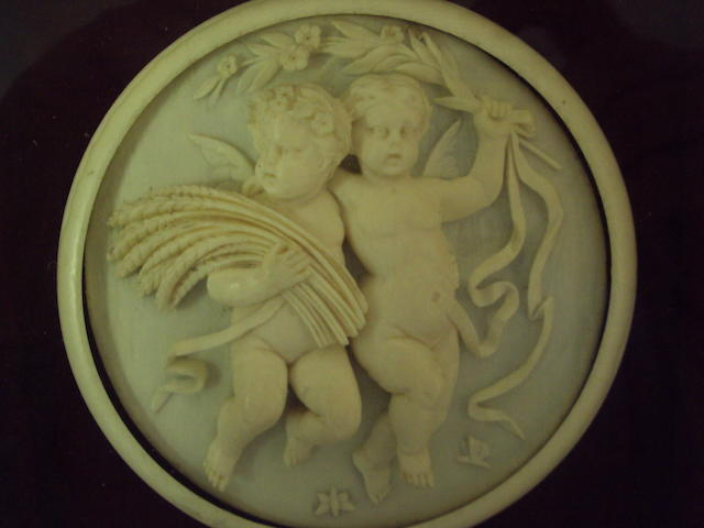 Four ivory relief-moulded plaques