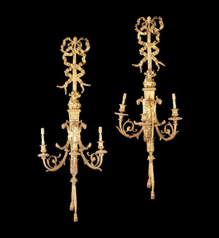 A large near pair of late 19th century ormolu triple branch wall lightsin the Louis XVI style