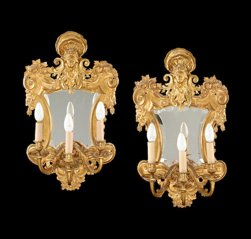 A set of four late 19th century Regence style gilt metal girandoles