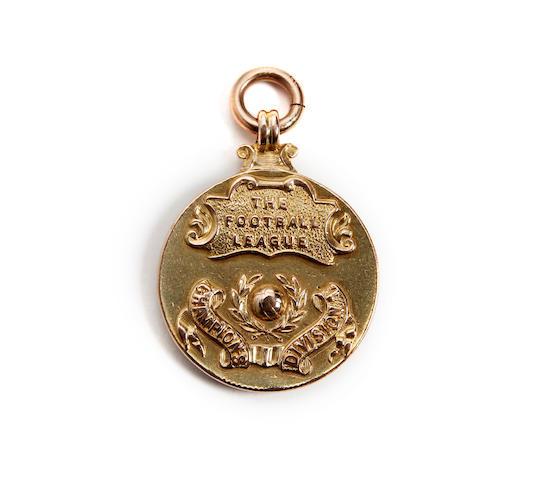 1933/34 League winners medal awarded to Arsenal's J.Birkett