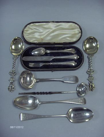 A toddy ladle, a sauce ladle, two table spoons, a christening KF&S and a pair of Dutch silver gilt spoons
