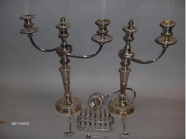 A pair of twin branch candlesticks one A/F, a toast rack, two sauce ladles and a salt spoon.