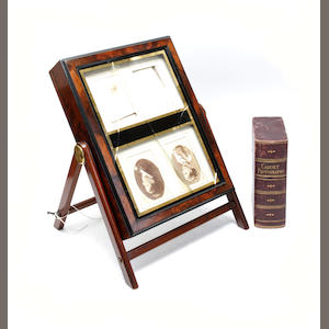 A Victorian walnut photograph display