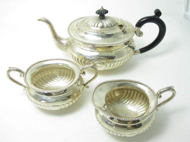 A three piece tea service stamped Sterling Silver & Serlinng Silver