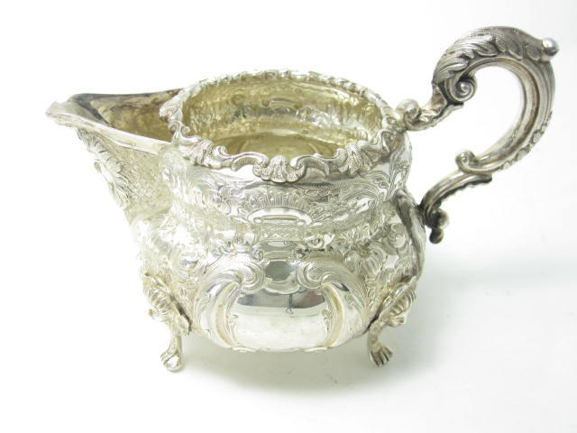 An Irish silver milk jug by West & Son, Dublin 1894